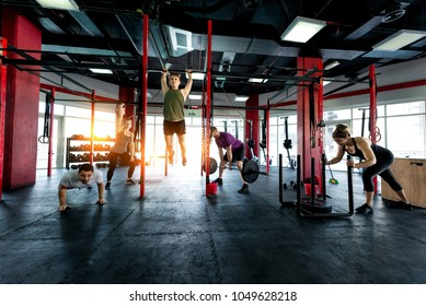 Muscular athletes training in a fitness studio - Functional training workout in a gym