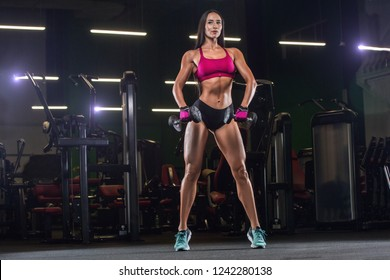 Muscular Athletic Bodybuilder Model Posing After Exercises