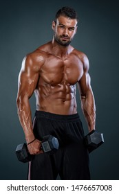 Muscular Athletic Men Exercise With Dumbbells