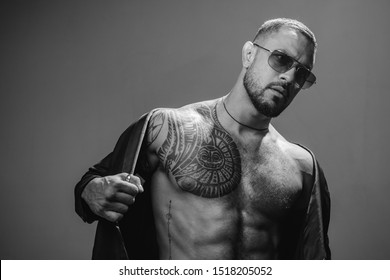 Muscular athletic sexy male with suit. Confident and handsome Brutal man. Men fashion Brutal models