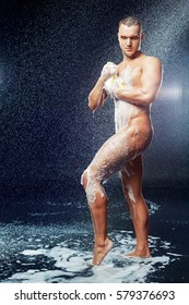 a muscular attractive young man taking shower