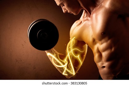 Muscular body builder lifting weight with energy lights on biceps concept