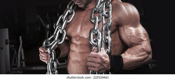 muscular body building men training with chain at the gym