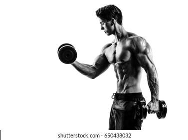 Muscular bodybuilder guy doing exercises with dumbbells over white background. isolate