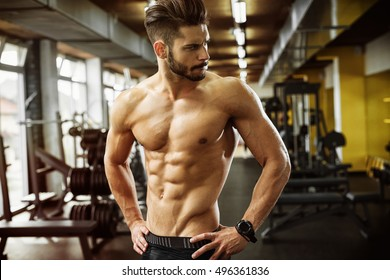 Muscular bodybuilder at a gym.