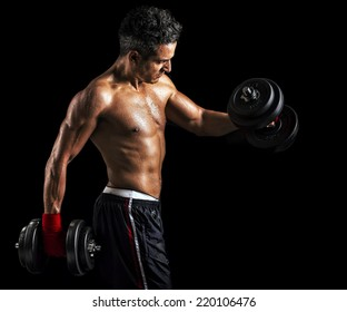 Muscular Bodybuilder Man Holding Dumbells, isolated on black background