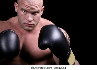 Muscular boxer isolated on black background
