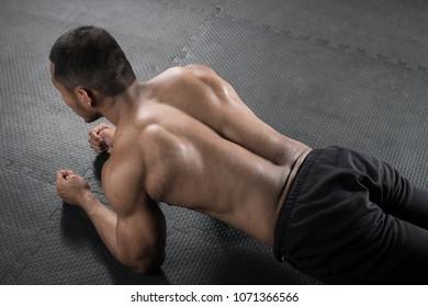 Muscular builder man sit-ups at gym.concept sport man in fitness centrer