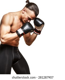Muscular fighter in boxing gloves on white background