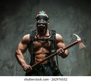 Muscular firefighter with naked torso on grey background