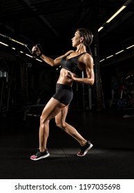 Muscular fit woman exercising building muscles