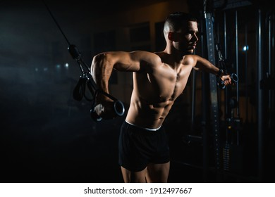 Muscular Fitness Bodybuilder Doing Heavy Weight Exercise In The Gym. Athlete doing pectoral muscle exercise. High quality photo