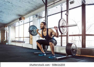 Muscular Fitness Man Doing Heavy Deadlift Exercise in the gym