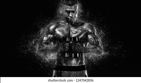 Muscular fitness sports man, atlete with dumbbell in fitness gym. Fire and power.