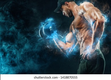 Muscular fitness sports man, atlete with dumbbell in fitness gym. Energy and power.