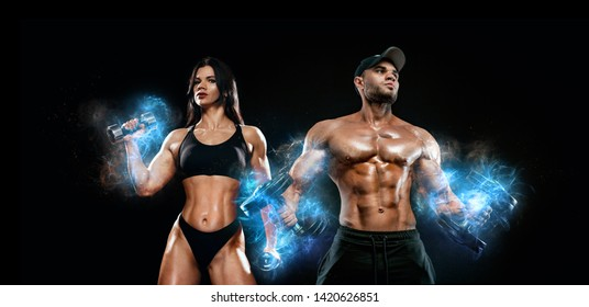 Muscular fitness sports man and fit woman, atletes with dumbbell in fitness gym. Energy and power.