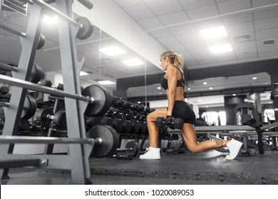 Muscular fitness woman doing squat exercises.Concept of healthy lifestyle.bodybuilder  in the gym
