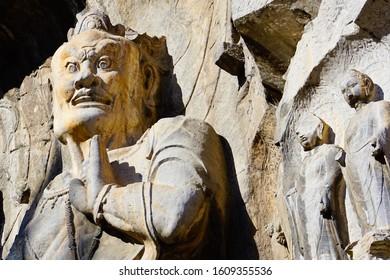 muscular guardian in Fengxian temple Longmen Grottoes Luoyang china