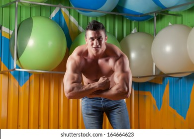 Muscular guy in fitness club
