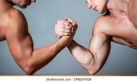 Muscular hand. Clasped arm wrestling. Two men arm wrestling. Rivalry, closeup of male arm wrestling. Two hands. Muscular men measuring forces, arms. Hand wrestling, compete. Hands or arms of man.