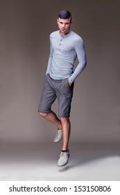 Muscular handsome man jumping in elegant dress
