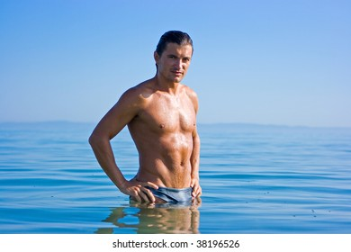 Muscular handsome man relaxing in the sea