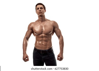 Muscular handsome young man with naked torso. Isolated on white background. Copy space