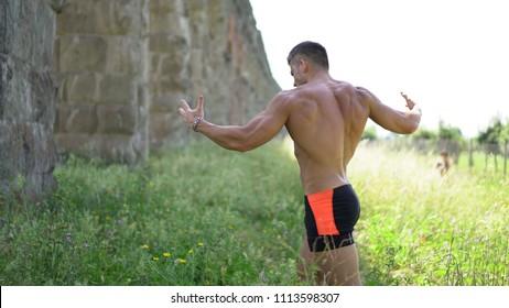 Muscular high level bodybuilder posing shirtless