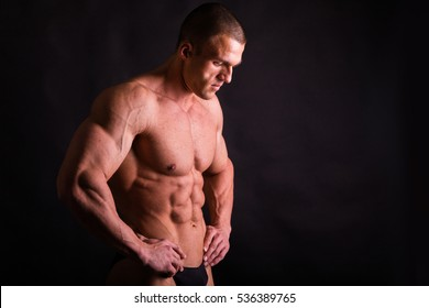 Muscular male body. Result bodybuilding workouts