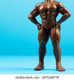 Muscular male mannequin. Bodybuilder doll on blue background.