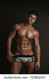 Muscular male model in blue underwear