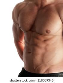 Muscular male torso of bodybuilder on white background