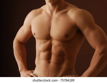 a muscular male torso with with olive skin