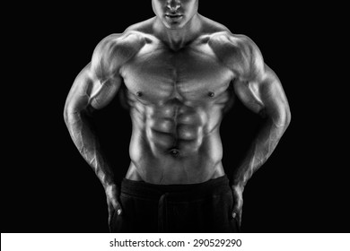 Muscular male torso. Perfect fit, six pack, abs, shoulders, deltoids, biceps, triceps and chest. Black and white image