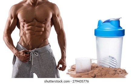 Muscular male torso, protein powder and shaker