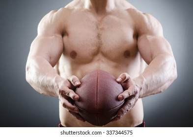 Muscular man with american football