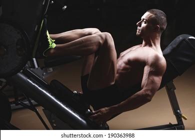 Muscular Man Calves - Bodybuilders Legs Shot In A Gym In Workout