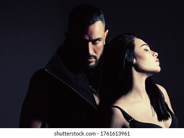 Muscular man. Couple in love on dark background. Relax. Fashion studio photo of beautiful couple. Couple In Love. Young sexy couple. Loving everything about her. Love. Beautiful young lovers