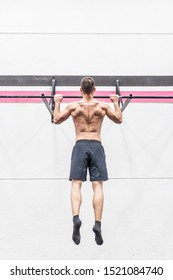 muscular man does back exercises in the box bar, calisthenics