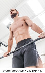 muscular man does exercises in the  box bar. calisthenics