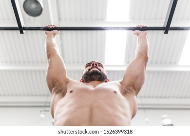 muscular man does exercises in the box bar, calisthenics