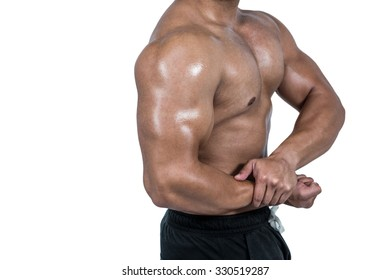 Muscular man flexing his biceps on white background