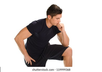 Muscular man with hand on knee thinking with thinker posture close up