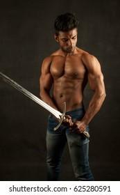 Muscular Man holding a sword