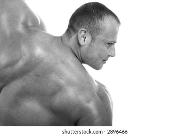 MUSCULAR MAN. ISOLATED ON WHITE. SHOT IN STUDIO.