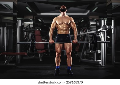 Muscular Man Lifting Some Heavy Barbells