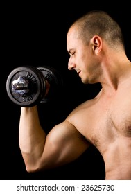 muscular man lifting weights, low key