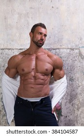 Muscular man on concrete background