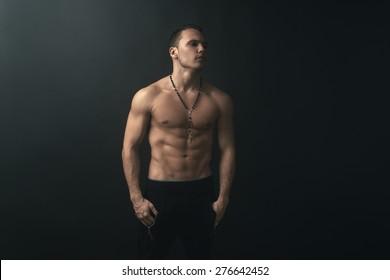 muscular man on a dark background