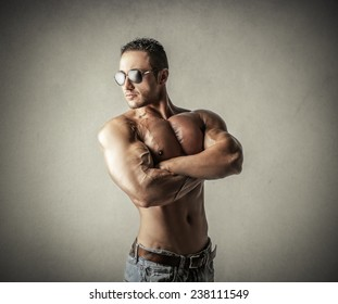 Muscular man posing for a picture
